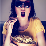 Girl Watching Movie eating popcorn